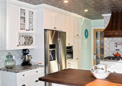 wood-countertop-white-painted-cabinets